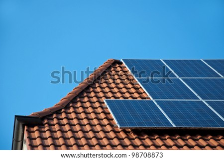 Photovoltaic cells on a roof - stock photo
