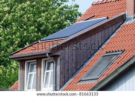 Photovoltaic on a red roof - stock photo