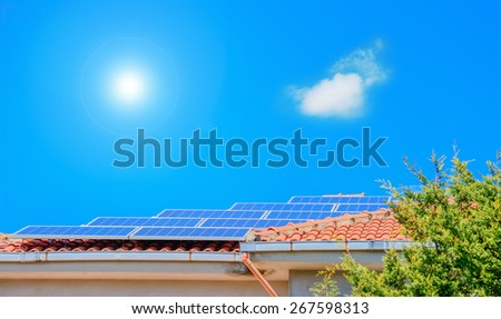photovoltaic panels on a orange house roof - stock photo