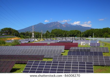 Photovoltaic power plant and mountain in japan - stock photo