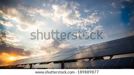Photovoltaic power plant on the background of a sunset - stock photo