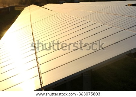 photovoltaic power station at sunset - stock photo