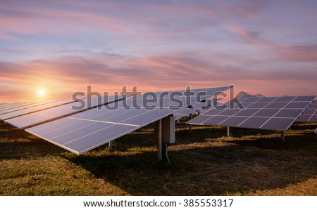 Photovoltaic solar energy panels and sunlight at sunset - stock photo