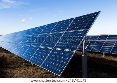 Photovoltaic technological construction of blue solar panels - stock photo