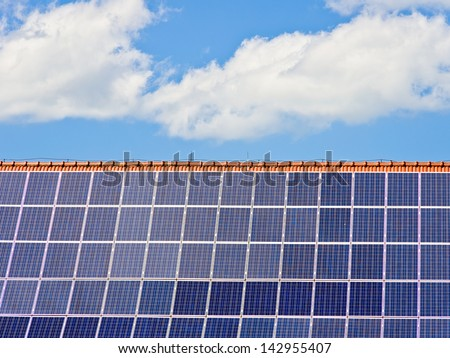 Photovoltaics - Photovoltaics on a residential roof makes a good self-providing power station and money machine. - stock photo