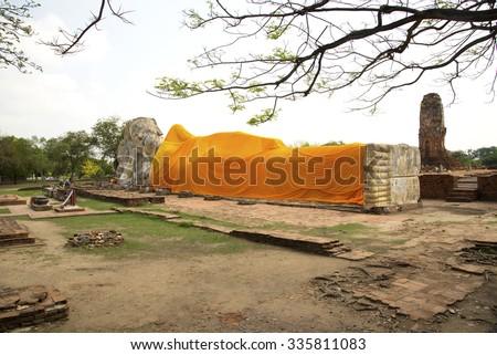 Phra Noon (Reclining Buddha) at Wat Lokayasutharam - stock photo
