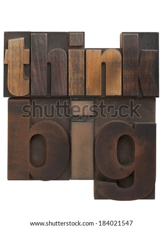 phrase think big in vintage wooden letterpress type, scratched and stained, isolated on white background - stock photo