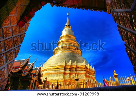 PHRATHAT HARIPHUNCHAI pagoda with blue sky in Thailand - stock photo