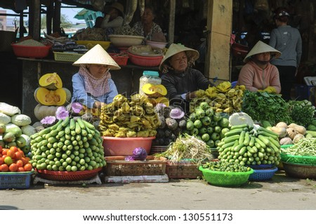 PHU QUOC, VIETNAM - FEB 17: Local farmers selling fresh produce at the farmer market on February 17, 2013 in Phu Quoc, Vietnam. This market is held daily and is the biggest on the island. - stock photo