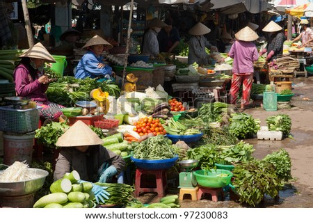 PHU QUOC, VIETNAM - FEB 27: Local farmers selling fresh products at the farmer market on February 27, 2012 in Phu Quoc, Vietnam. This market is held every day and is the biggest on the island. - stock photo