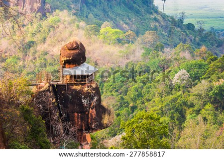 Phu tok mountain or Wat Jetiyakiree Viharn Temple with wooden trail round of the 7 floors mountain at Bueng Kan Province, Thailand - stock photo