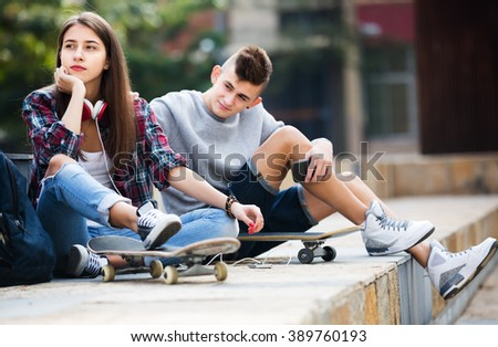 Phubbing: portrait of teenager and friend asking for attention - stock photo