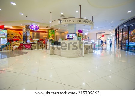 Phuket, 22 May 2014: First floor of Central Festival mall with tourist information stand at Phuket Town, Phuket province, Thailand. - stock photo