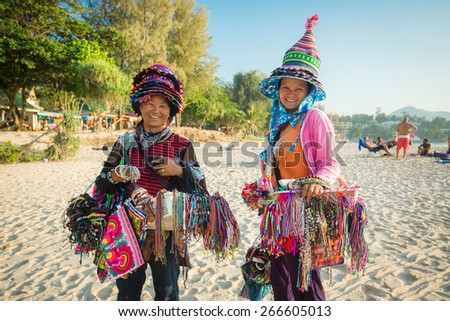 Phuket, Thailand - January 24,2015: Thai women selling beachwear and souvenirs at beach in Phuket, Thailand. - stock photo