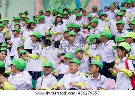 PHUKET, THAILAND - JUL 13 : Cheering team schoolchild in the stadium on July 13, 2016.  Yearly athletics competition of Anuban Phuket School in phuket, Thailand - stock photo