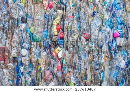 PHUKET, THAILAND - MARCH 3 : Crushed plastic bottles at a recycling facility in Phuket on March 3, 2015. The bottles will be shipped to a plastic foundry. - stock photo
