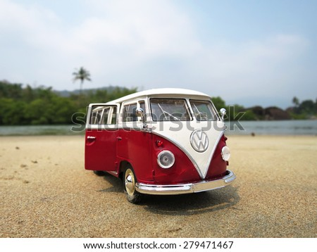 PHUKET, THAILAND - MARCH 27, 2015: Miniature VW Bulli 1962 on the beach. The cult car of the Hippie generation and it remained the status vehicle of the high wave surfers - stock photo