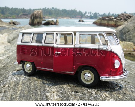 PHUKET, THAILAND - MARCH 27, 2015: Miniature VW Bulli 1962 on the rock. The cult car of the Hippie generation and it remained the status vehicle of the high wave surfers - stock photo