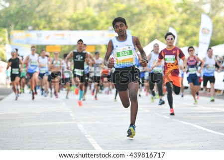 PHUKET, THAILAND - MAY 04:Babu Seenappa no.6353 run in 10.5km. race during the Laguna Phuket International marathon at Laguna on May 04, 2016 in Phuket, Thailand. - stock photo