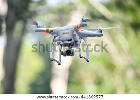 PHUKET,THAILAND-MAY 05:Flying drone quadpter Dji Phantom 3 during the Laguna Phuket International marathon at Laguna Phuket Resorts and Hotels on May 05, 2016 in Phuket,Thailand. - stock photo