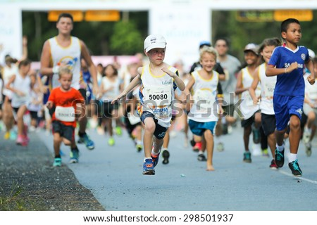 PHUKET, THAILAND - MAY 07: Unidentified children just after the start in a Kids' Run race during  the Laguna Phuket  International marathon at Laguna on May 07, 2015 in Phuket, Thailand. - stock photo