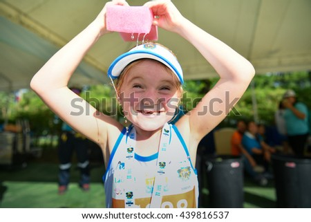 PHUKET, THAILAND - MAY 04: Unidentified young athletes in a action after a Kids' Run race during the Laguna Phuket International marathon at Laguna on May 04, 2016 in Phuket, Thailand. - stock photo
