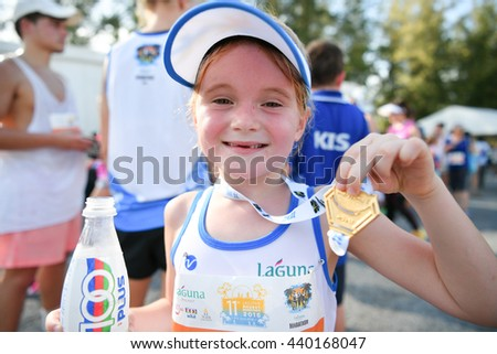 PHUKET, THAILAND - MAY 04: Unidentified young athletes in action during after the Kids' Run at the Laguna Phuket International marathon at Laguna on May 04, 2016 in Phuket, Thailand. - stock photo