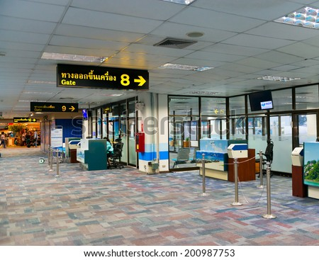 PHUKET, THAILAND - 21 NOV 2013: Domestic departure terminal waiting hall with gates in Phuket international airport - stock photo