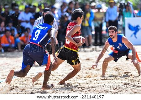PHUKET,THAILAND-NOV14:Saranloet Phithaya#8 of Thailand is tagged during Beach Flag Football Kuwait and Thailand during the 2014 Asian Beach Games at Saphan Hin on NOVEMBER14,2014 in Thailand. - stock photo