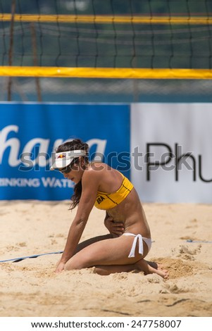 PHUKET, THAILAND-NOVEMBER 1: Carolina Solberg Salgado of Brazil reacts after losing a point during Day 3 match of Phuket Open on November 1, 2013 at Karon Beach in Phuket Thailand - stock photo
