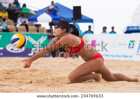 PHUKET THAILAND-NOVEMBER21:Meim ei Lin #2 of China hit the ball during the Beach Volleyball match between China and Thailand the 2014 Asian Beach Games at Karon beach on Nov 21,2014 in Thailand - stock photo