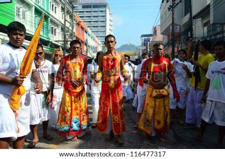 PHUKET, THAILAND - OCTOBER 20: An unidentified devotee of a Chinese shrine  take part in the 2012 Vegetarian Festival on October 20, 2012 in Phuket, Thailand - stock photo