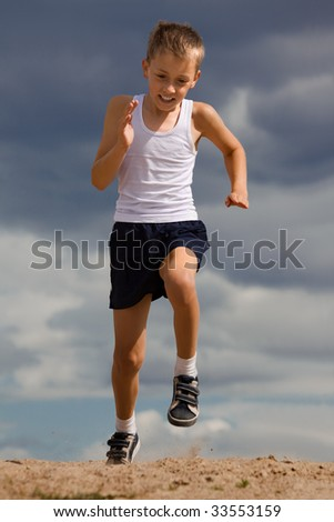 Physical drill of little boy(running) - stock photo