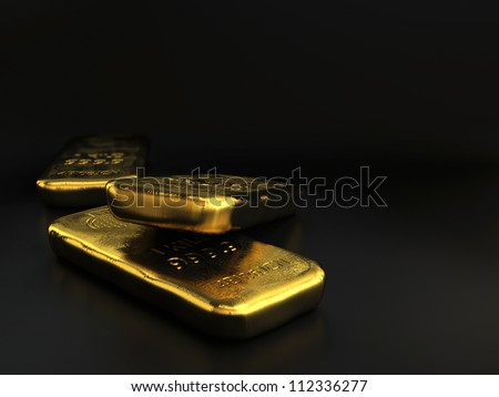 physical gold bullion ingots, golden bars over black background with room for text - stock photo