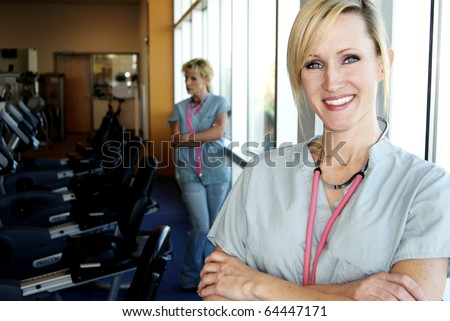 Physical Therapy blond nurses - stock photo