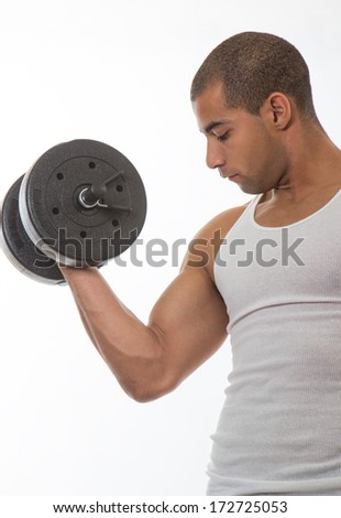 Physically fit hispanic man working out - stock photo