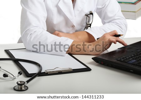 Physician searching information in the Internet - stock photo