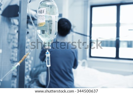 Physician works with critically ill patient in hospital - stock photo