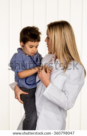 physicians and little boy - stock photo