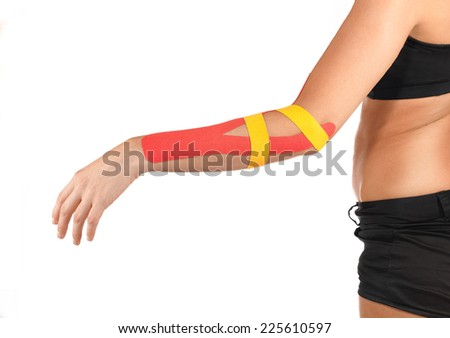 Physiotherapy treatment with therapeutic tape for elbow pain, aches and tension. It is also used for prevention and treatment in competitive sports.  - stock photo