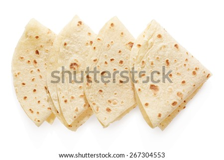 Piadina, italian tortilla triangles isolated on white, clipping path included - stock photo