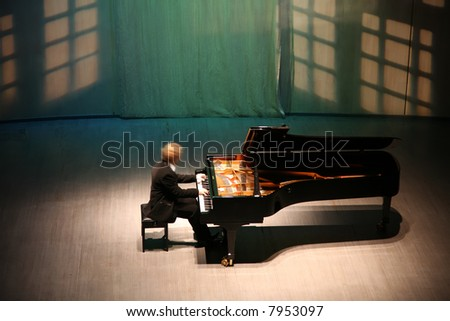 pianist after the piano on the scene - stock photo