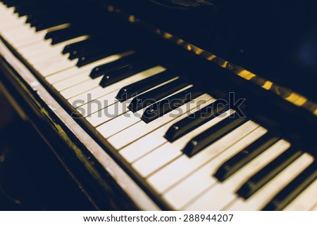Piano keyboard background with selective focus. - stock photo