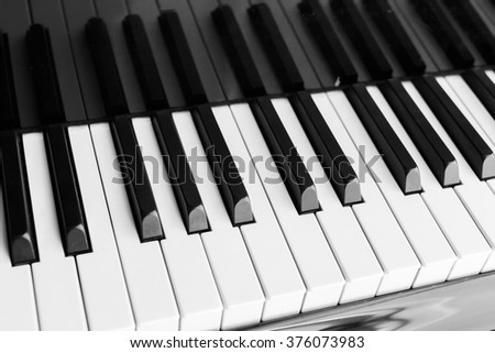 Piano keyboard background with selective focus - vintage filter - stock photo