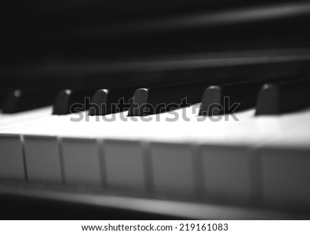 Piano keyboard in black and white. - stock photo
