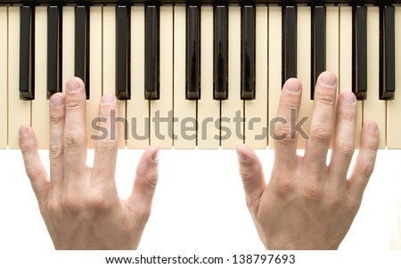 Piano keyboard with hands on white background - stock photo