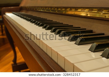 Piano keys in warm color tone - stock photo