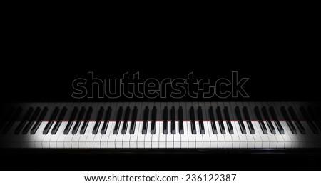 piano keys on black piano - stock photo