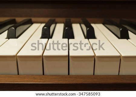 Piano keys on wooden musical instrument - stock photo