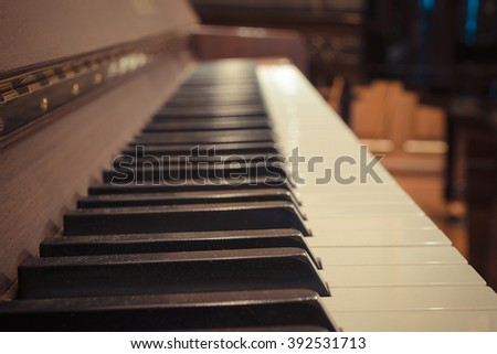 Piano keys on wooden musical instrument , process in vintage style - stock photo